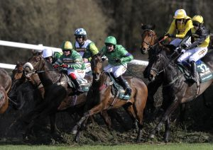 Mon Mome (green/purple) en route to Grand National glory