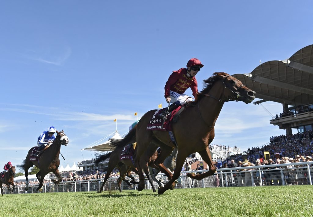 Lightning Spear and Oisin Murphy cross the line to win the Sussex Stakes at Goodwood