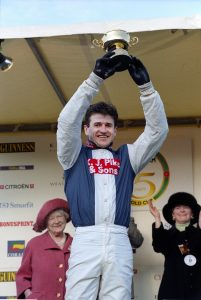 Andrew Thornton celebrates winning the Cheltenham Gold Cup on Cool Dawn
