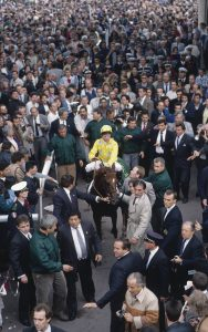 Kinane coming into the winners enclosure aboard 1989 Arc hero Caroll House