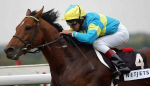 Holland wins the Group 1 Queen Elizabeth II Stakes on Falbrav in 2003