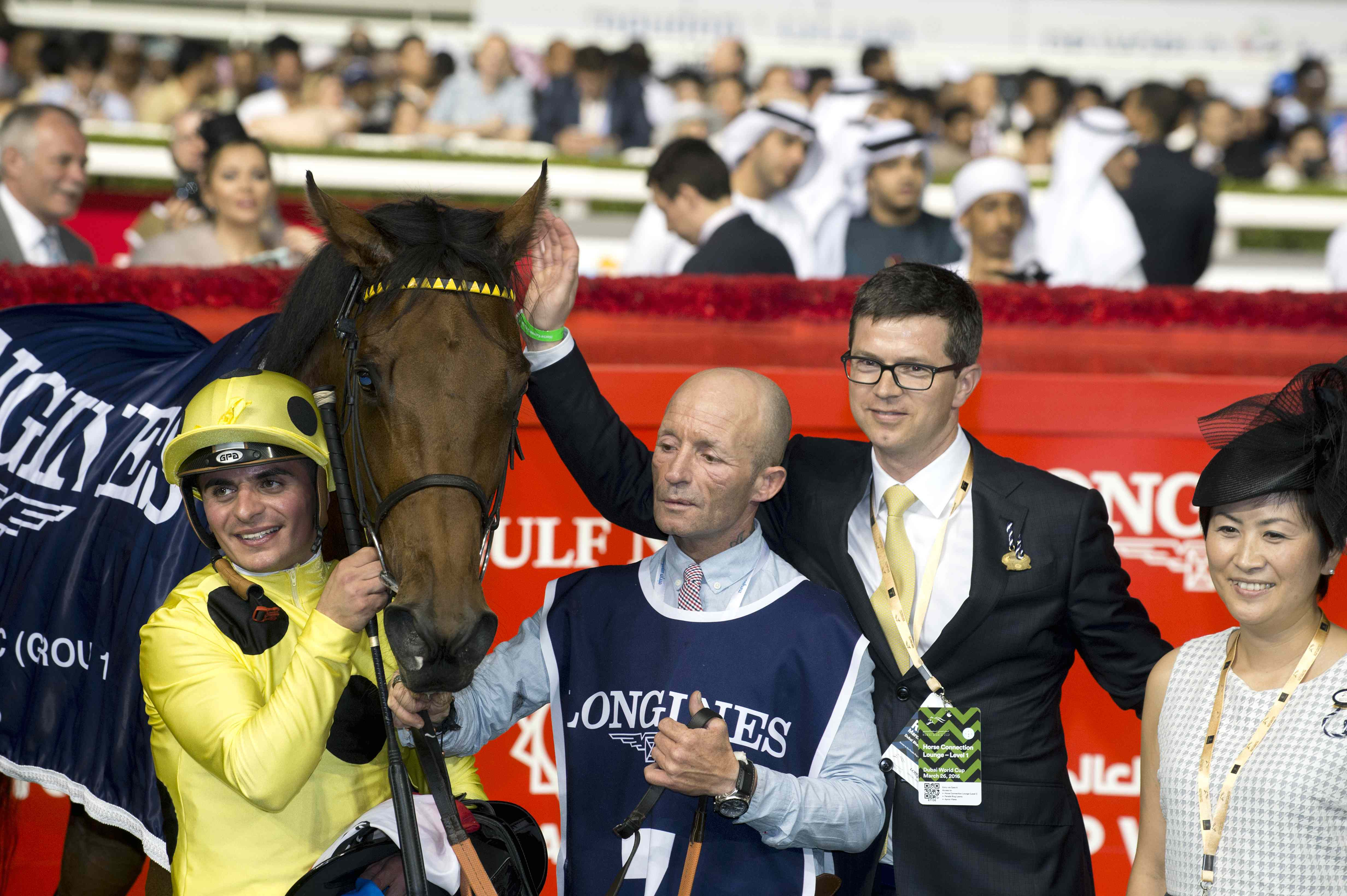 Roger Varian and wife Hanako celebrate Dubai Sheema Classic success with Postponed and jockey Andrea Atzeni