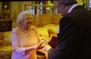 The Queen, seen on screen accepting her Cartier Award from Arnaud Bamberger
